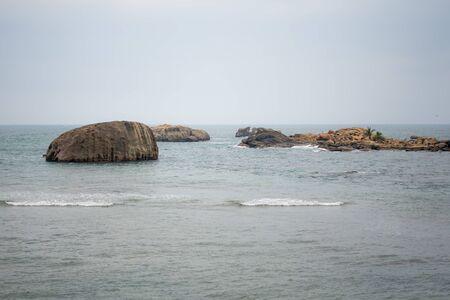 Rocks or large stones in the Indian Ocean near Galle Fort in Sri Lanka Stock fotó