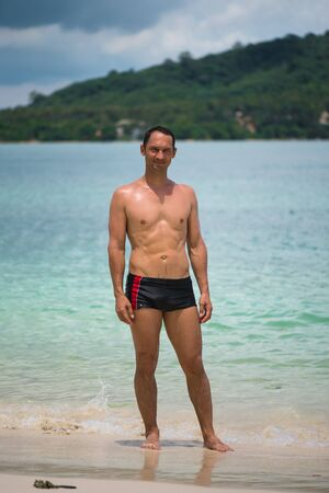 Portrait of a handsome happy man at tropical resort with smile on Rang Yai Island in Thailand