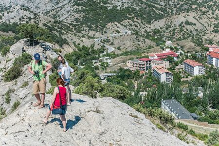 SUDAK, RUSSIA - JULY, 22, 2016 Tourists and view from an ancient Genoese fortress in the city of Sudak, Crimea, Russia 新聞圖片