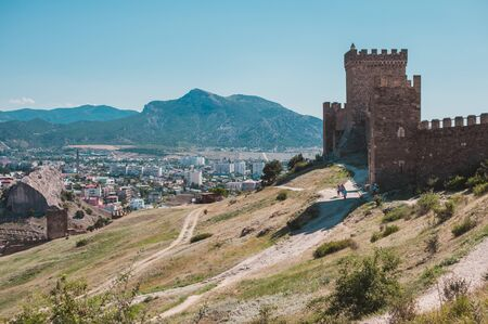 SUDAK, RUSSIA - JULY, 22, 2016 Walls and towers of an ancient Genoese fortress in the city of Sudak, Crimea, Russia 新聞圖片