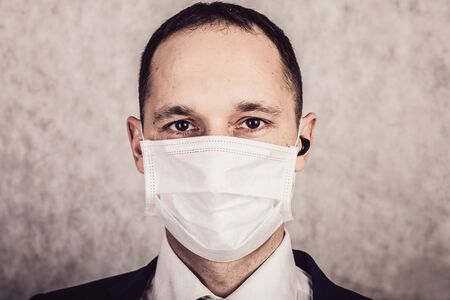 Close up portrait of handsome man in a protective medical mask, virus protection concept