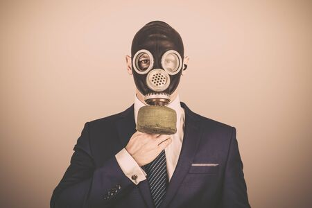Close up portrait of handsome man in a protective gas mask, virus protection concept 版權商用圖片