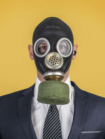 Close up portrait of handsome man in a protective gas mask, virus protection concept. Businessman Style spring-summer 2020