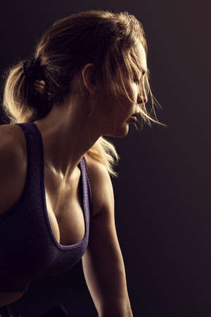 Beautiful Slim athletic woman on black background.