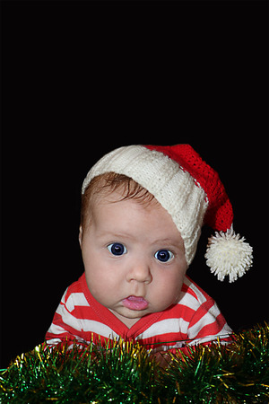 Cute Santa girl with dumbfounded face dressed in red santa hat and stripped red jacket isolated on black background. Can be used for design of banners, flyers, calendars, invitations as clip art.