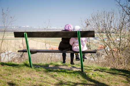 two children sitting on the bench