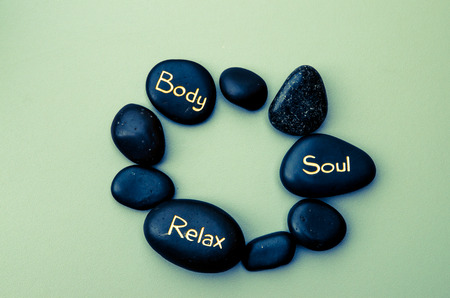 black lava stones with word of relaxation photo
