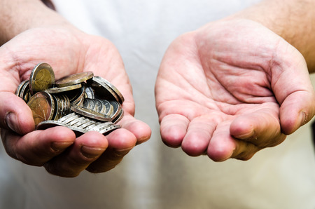 group of coins in human hand and empty hand 스톡 콘텐츠
