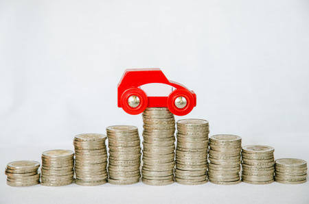 detail of coins and car on white background photo