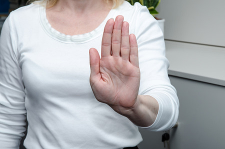 hand with stop gesture on white background photo