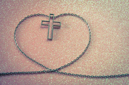 silver cross symbol in love shape image photo