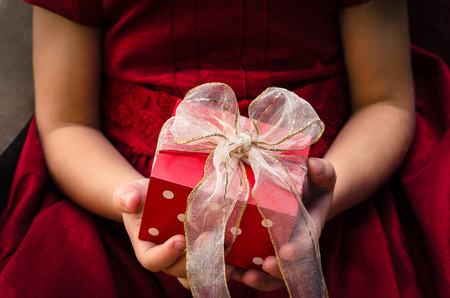 red gift box: red gift box in children hands