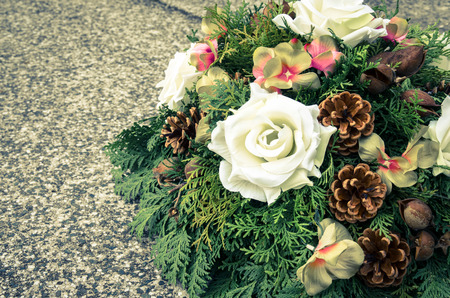 floral wreath decoration lying on the grave photo