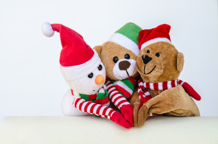 beautiful christmas concept with teddy bear and snowman photo