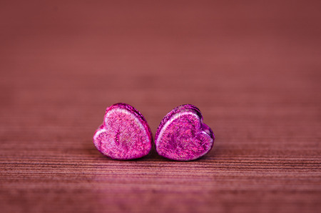 two pink hearts on violet background photo