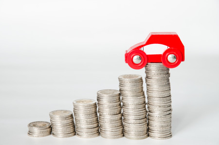 coins in pile and car isolated image