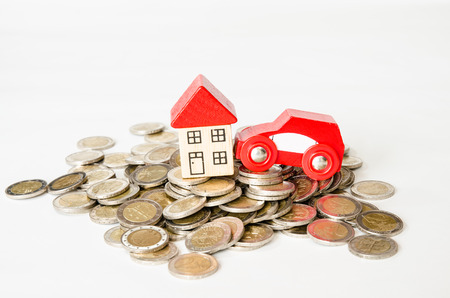 coins in pile and house, car isolated image photo