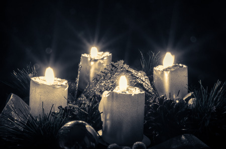 burning candles over advent wreath photo