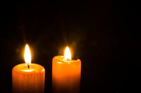 burning candles over dark background