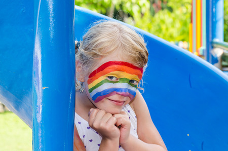face painting: beautiful blond girl with face painting Stock Photo