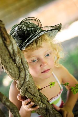 beautiful blond girl thinking image photo