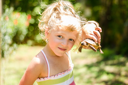 children turtle: beautiful blond girl with turtle image