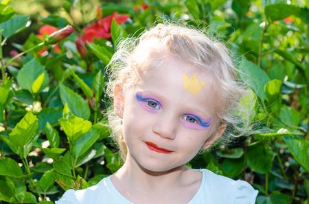face painting: beautiful blond girl with princess face painting