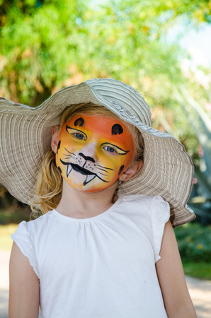 face painting: beautiful blond girl with tiger face painting Stock Photo