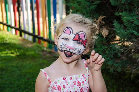 hallo: beautiful blond girl with hallo kitty face painting