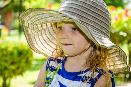 beautiful blond girl with hat photo
