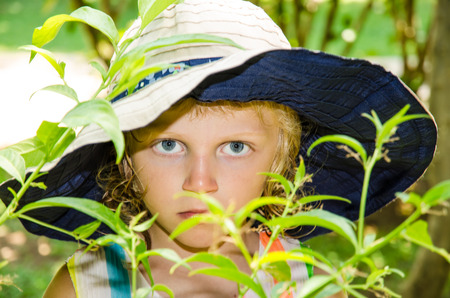 beautiful blond girl with hat and big blue eyes photo