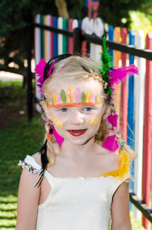 face painting: beautiful blond girl with indian face painting Stock Photo