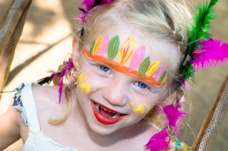 beautiful blond girl with indian face painting photo