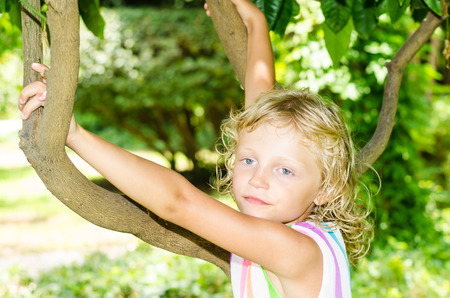 beautiful blond girl with blue eyes photo