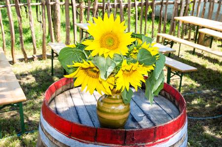 bunch of sunflowers on barrel photo