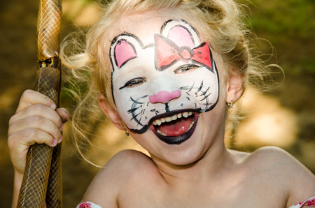 face painting: blond girl with cat face painting