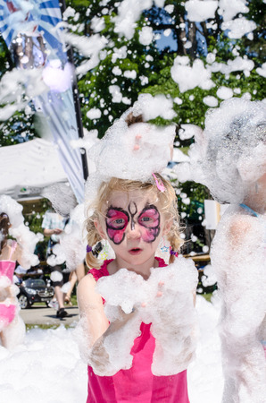 foam party: blond girl with face painting and foam party