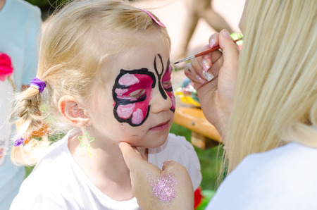 blond girl with face painting