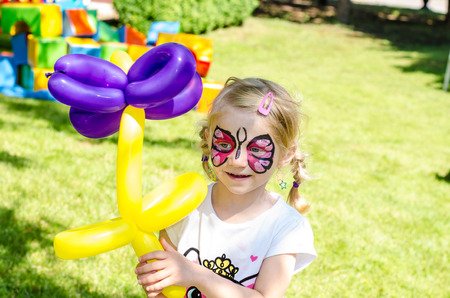 blond girl with face painting photo