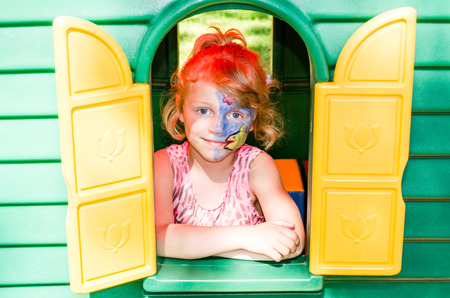 face painting: blond girl with face painting