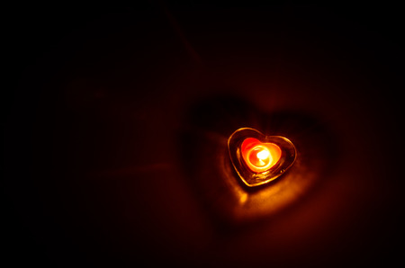 burning love: burning candle with red love shape