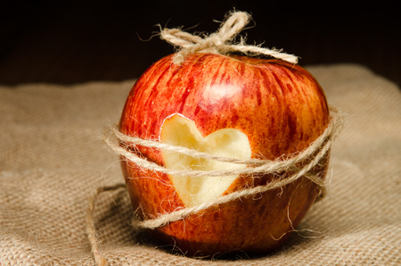 chained: chained red apple with heart on it Stock Photo