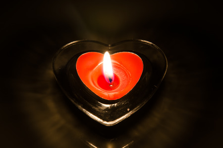 red burning candle photo