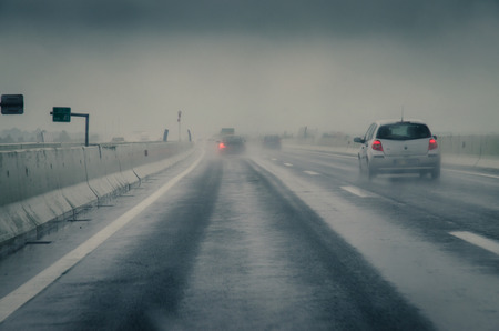 car on a road in rainy weather 스톡 콘텐츠