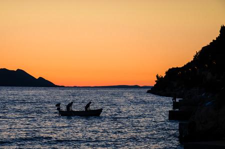 fishman: fishmen in boat on sea