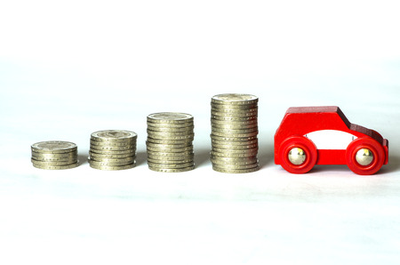 several piles of money on white background photo