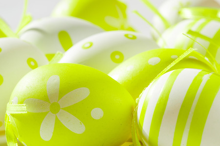 green and white easter eggs with dots decoration isolated photo