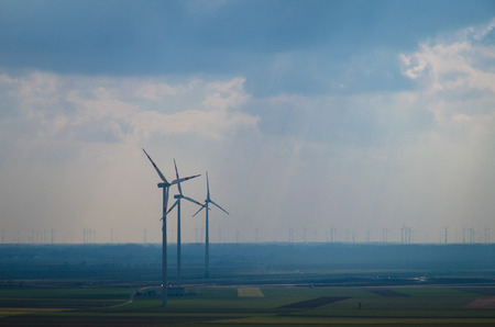 windmills over green field image