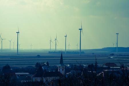 windmills: several windmills and village image