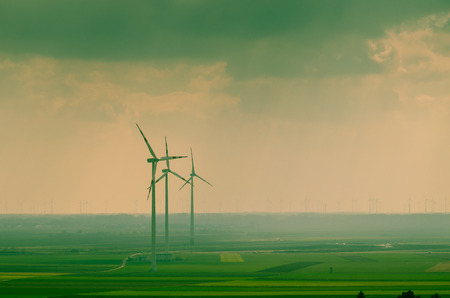 subset: windmills over green field image